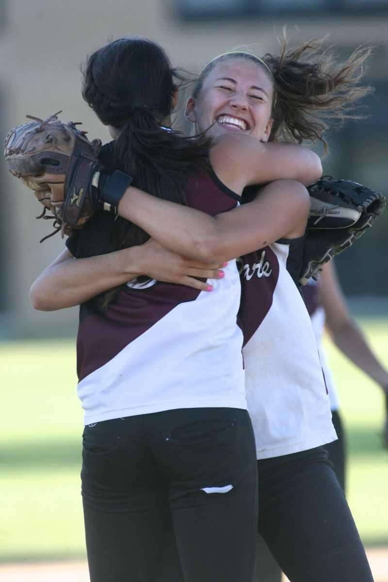 Kings Park's Nicole Tortlincasi (right) and pitcher Lindsay