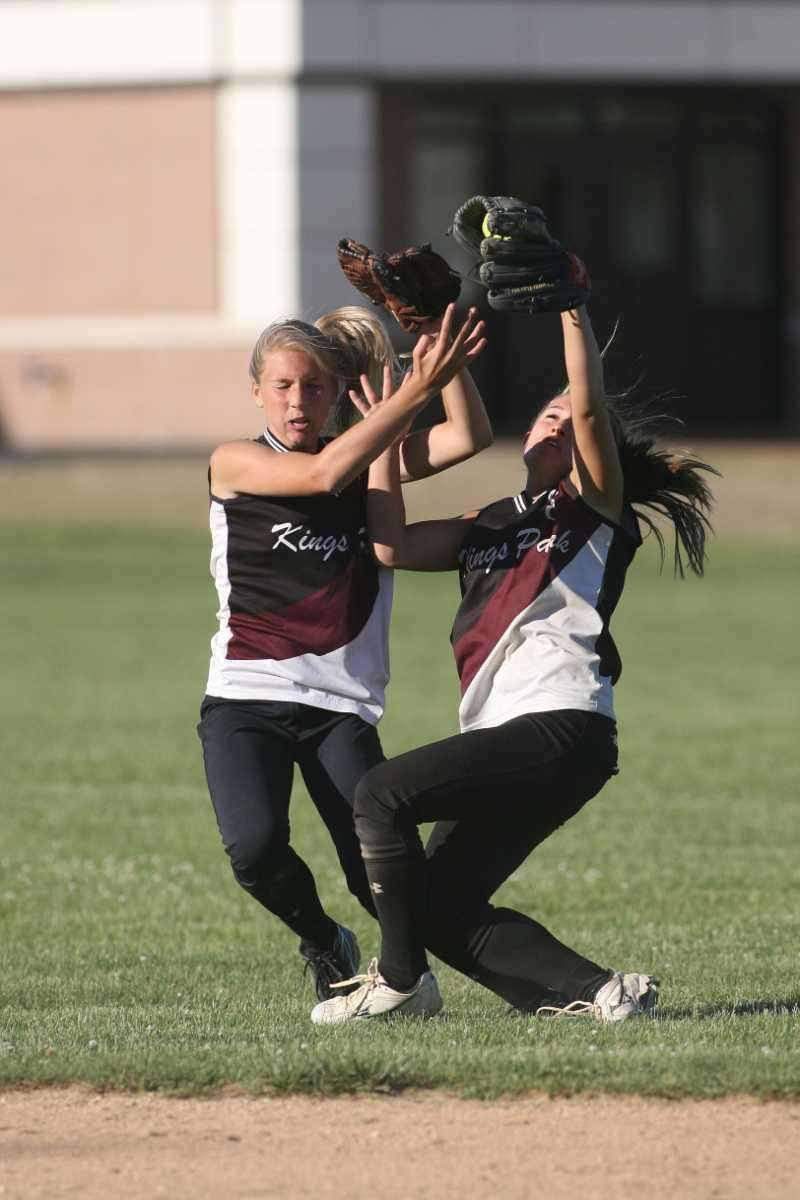 Kings Park's SS Nicole Brieva (right) catches and