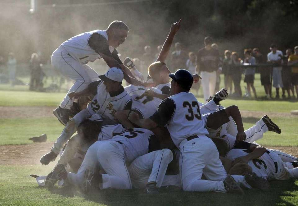 Shoreham baseball players celebrate their county championship victory