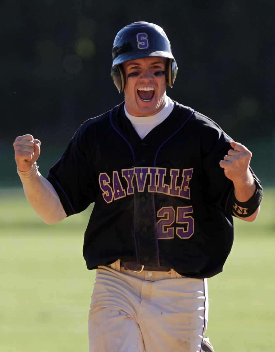 Sayville's Richie Millwater (25) rounds the bases cheering