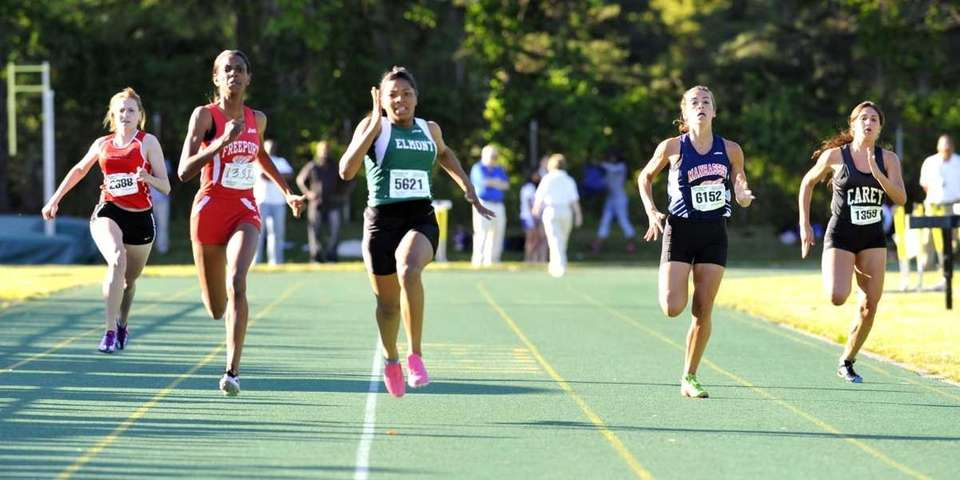 Valencia Hannon of Elmont, center, wins the girls