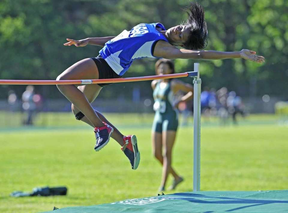 Joane Imbert of Valley Stream Central clears the