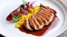 Sliced duck breast served with a balsamic teriyaki