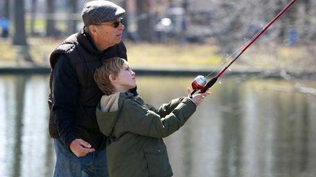 Bob Hurd of Smithtown gives his grandson, Ryan