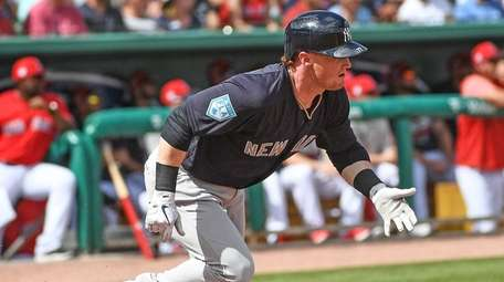 The Yankees' Clint Frazier singles in the first