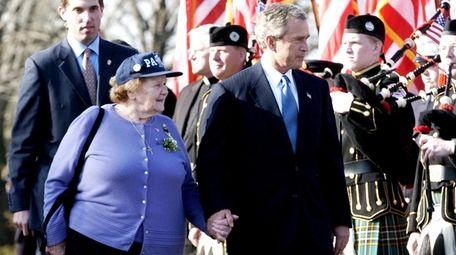 President George W. Bush walks with Arlene Howard