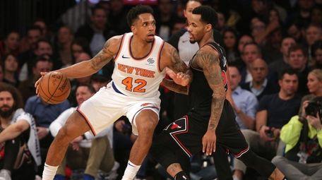 Knicks small forward Lance Thomas (42) controls the