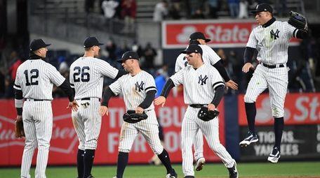 New York Yankees players celebrate their 3-1 win