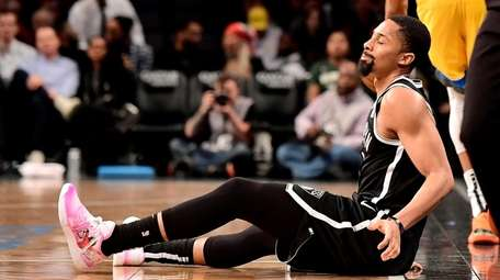 Spencer Dinwiddie #8 of the Nets reacts against