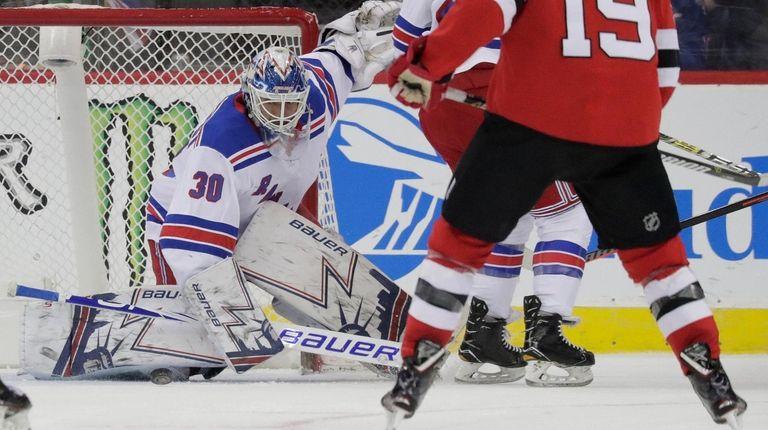 Rangers goaltender Henrik Lundqvist (30) makes a save