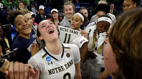 Notre Dame's Marina Mabrey (3) celebrates after defeating