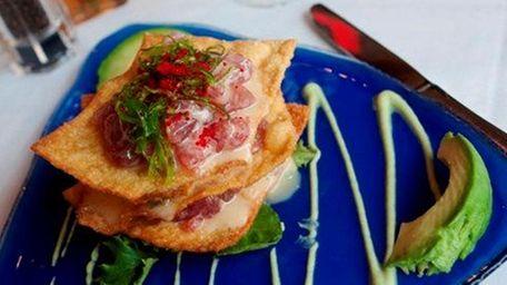Tuna Napoleon is served with seaweed salad, crispy