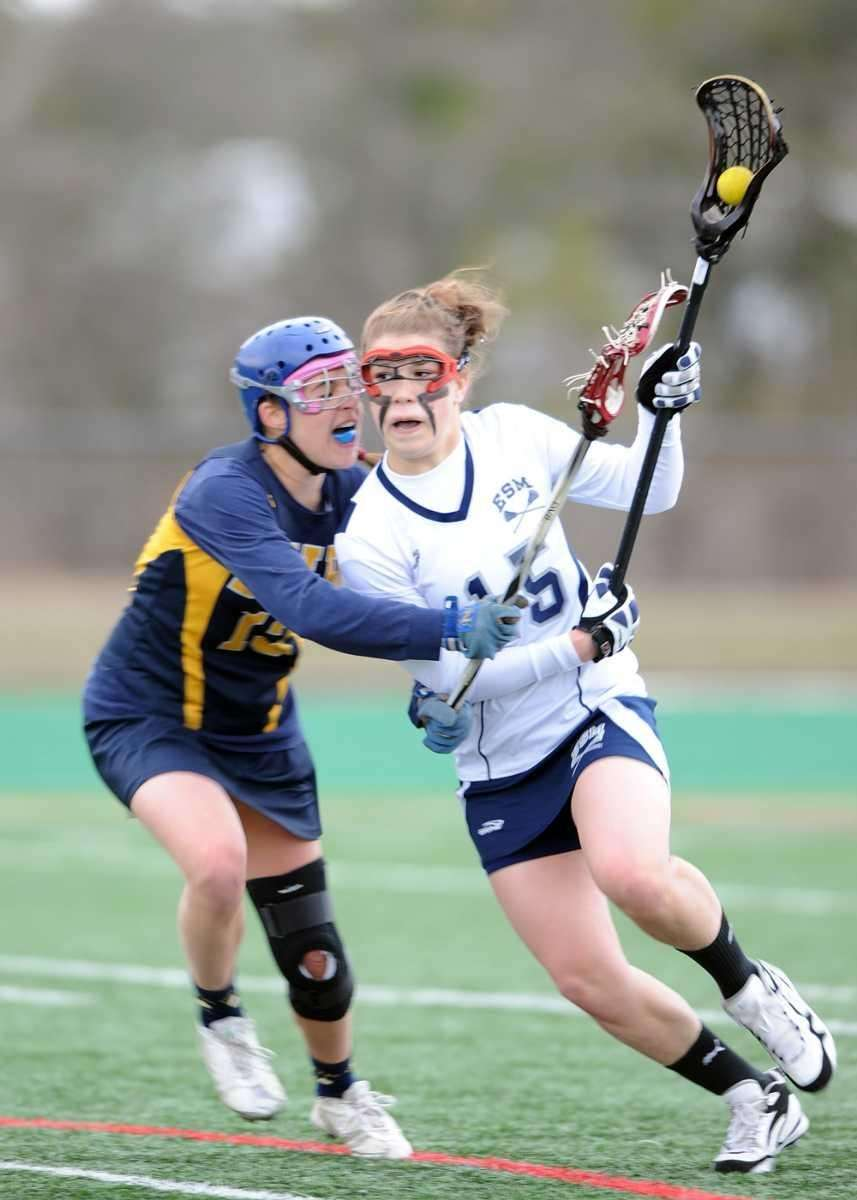 Eastport's Dene DiMartino (15) drives to the goal