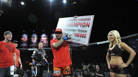 Jay Hieron celebrates his $100,000 paycheck as winner