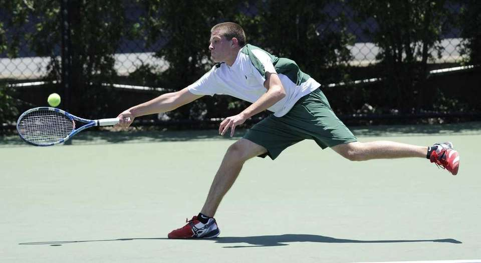 Brendan Henry of Farmingdale stretches to return the