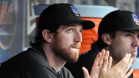 Mets first baseman Ike Davis sits in the