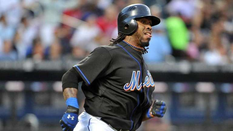 Mets shortstop Jose Reyes rounds first base after
