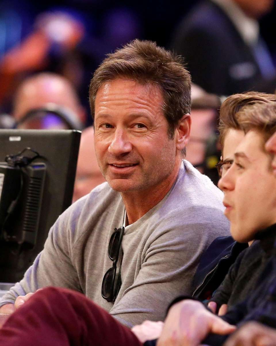 Actor David Duchovny attends a game between the