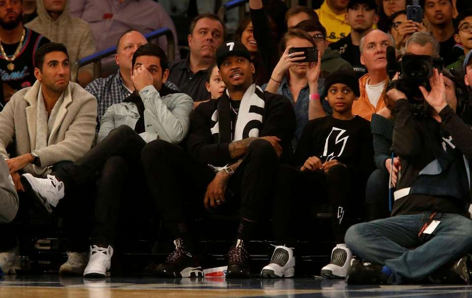 Carmelo Anthony attends a game between the New