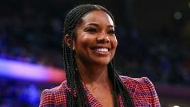Actress Gabrielle Union watches her husband, Dwyane Wade,