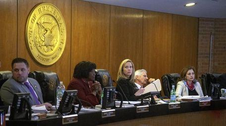 Hempstead Supervisor Laura Gillen, center, voted against accepting