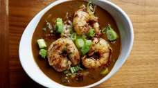 The robust shrimp gumbo starts with a dark