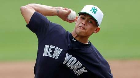 Yankees starting pitcher Jonathan Loaisiga works in the