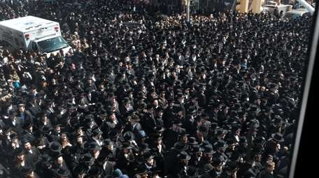 Thousands of mourners gather Tuesday in Borough Park,