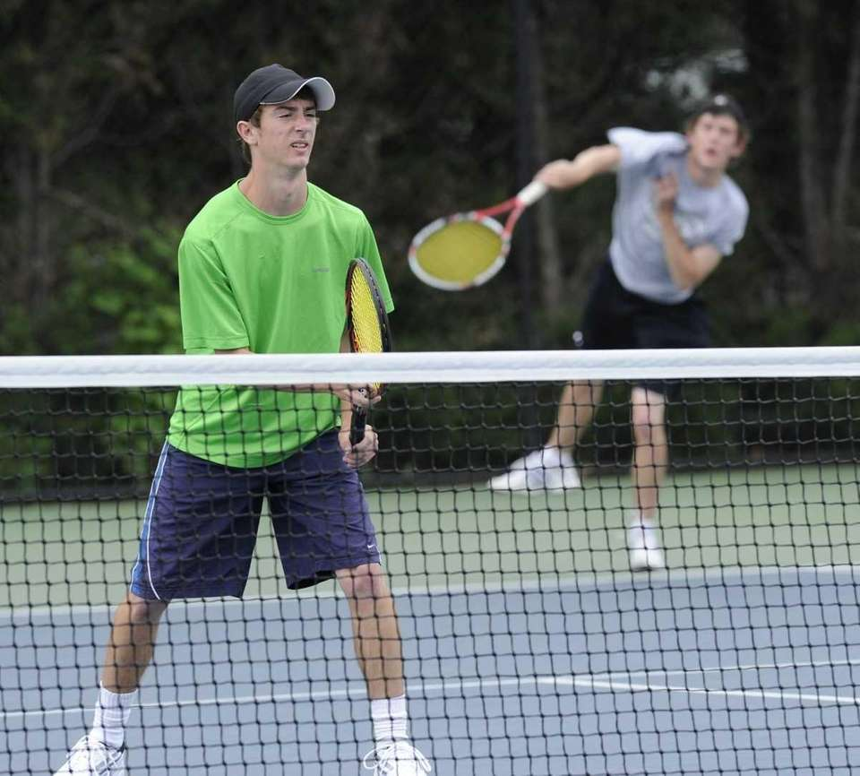 Sachem East's doubles team of Quintana/Quintana competes in