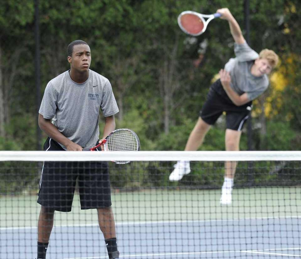 The doubles team of J.J. Tauil, left, and