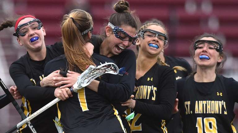 Kira Accettella of St. Anthony's gets congratulated by