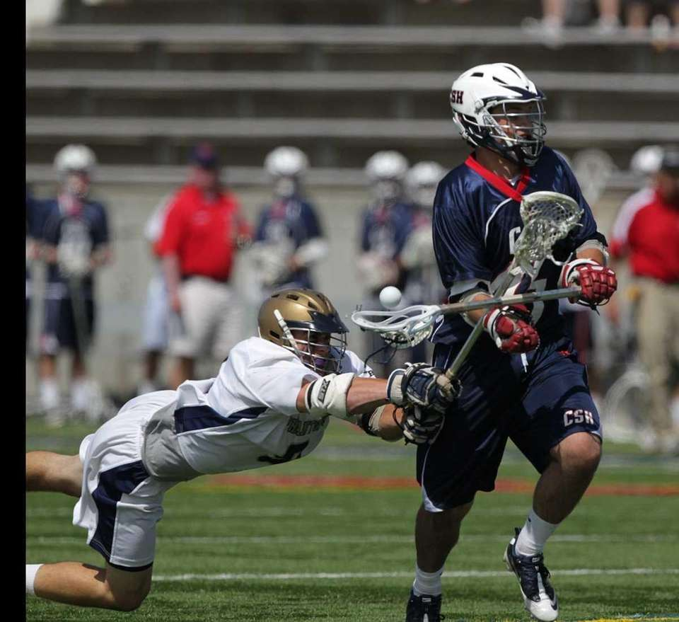 Bayport's Sean Doyle (9) stick checks the ball