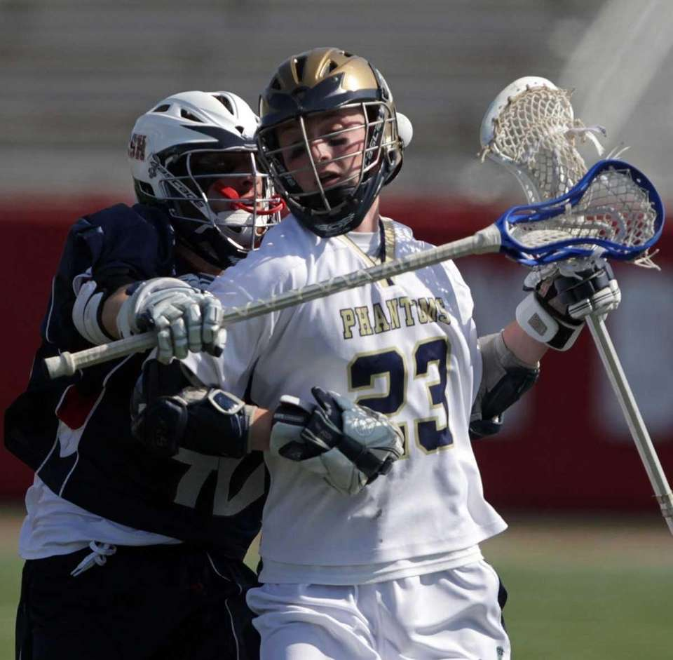 Cold Spring Harbor's Danny Simonetti stick checks the
