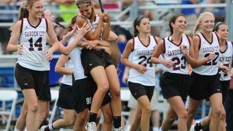 Garden City High School varsity girls lacrosse teammates