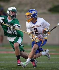 Farmingdale's Kevin Wahl (40) defends West Islip's Conor