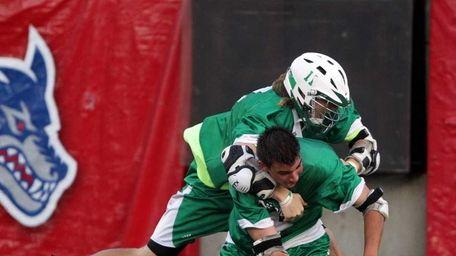 Farmingdale's Sal Tuttle (11) hugs teammate Mike Perettine