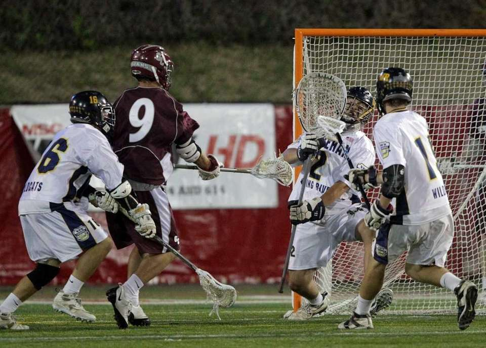 Garden City'sRob Savage (9) shoots and scores to