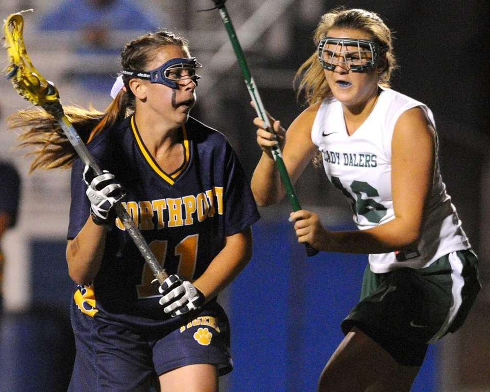 Northport's Shannon Gilroy, left, gets pressured by Farmingdale's