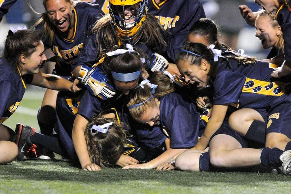 Northport High School varsity girls lacrosse teammates celebrate