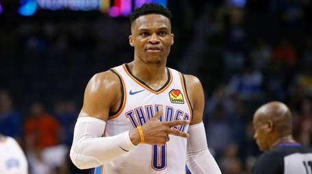Thunder guard Russell Westbrook gestures to the crowd