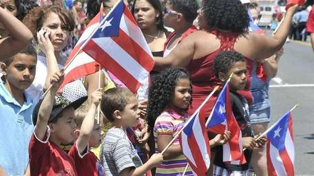 Residents and children take in the Puerto Rican/Hispanic