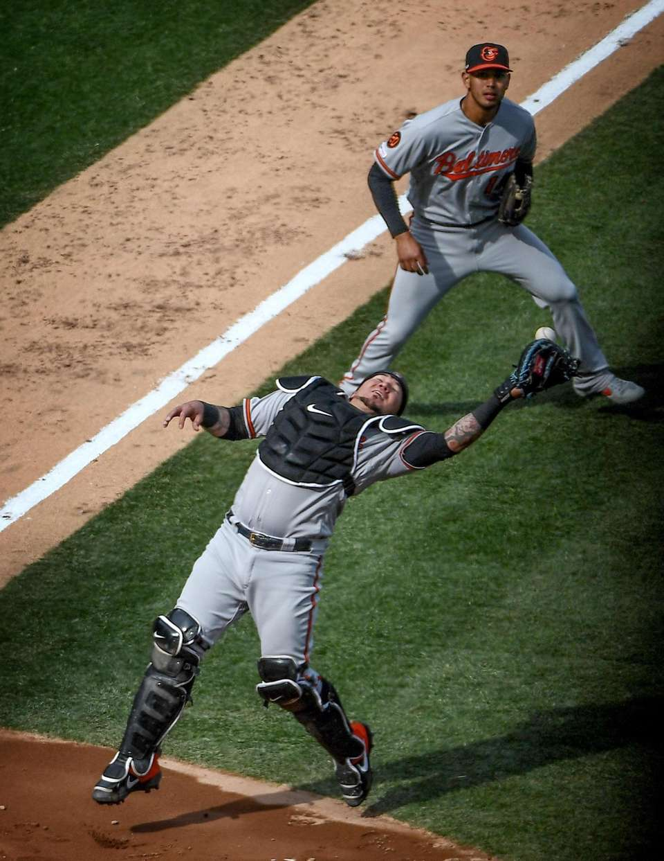 Baltimore Orioles catcher Jesus Sucre drops a pop
