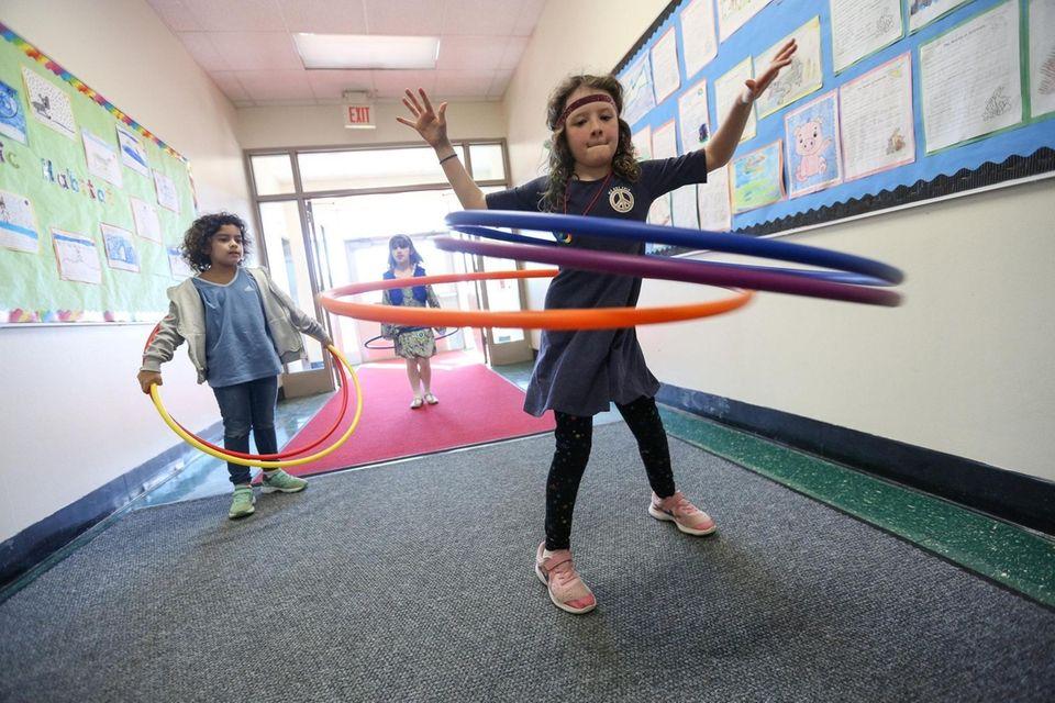 Second grader, Sarah Reddington shows off her hula