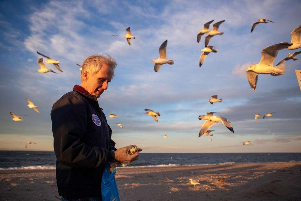 Steven Scott, Rocky Point, feeds the seagulls at