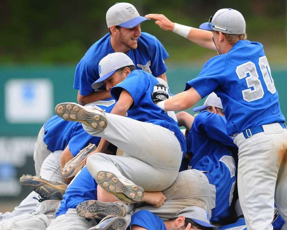 Division Avenue High School varsity baseball players celebrate