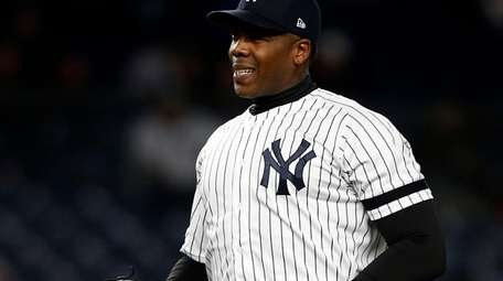 Yankees closer Aroldis Chapman reacts on the mound