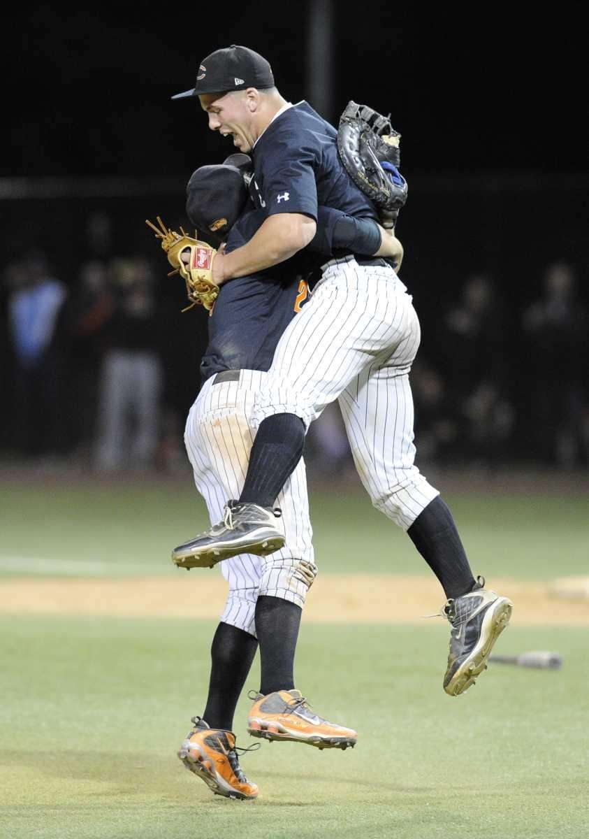 Carey pitcher John Daddino, right, is hugged by