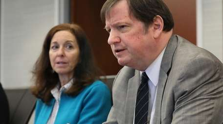 Attorney E. Christopher Murray, right, is joined by