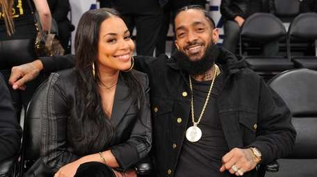 Lauren London and Nipsey Hussle attend a basketball