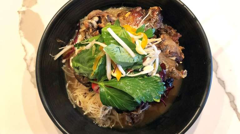 Duck wings with vermicelli and Thai basil were